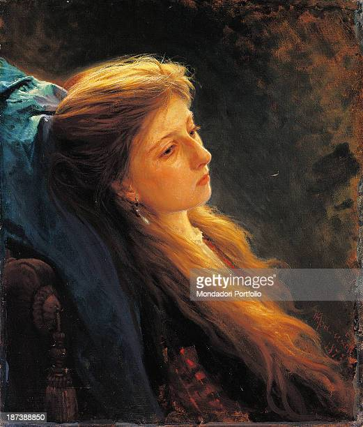 Russia Moscow State Tretyakov Gallery all Young woman with the braid of long hair down around her face rests her head on a blue cloth and wears an...