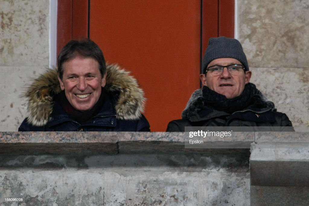 Russia national team head coach <a gi-track='captionPersonalityLinkClicked' href=/galleries/search?phrase=Fabio+Capello&family=editorial&specificpeople=241290 ng-click='$event.stopPropagation()'>Fabio Capello</a> (R) and his assistant Oreste Cinquini attend the Russian Premier League match between FC Zenit St. Petersburg and FC Anzhi Makhachkala at the Petrovsky Stadium on December 10, 2012 in St. Petersburg, Russia.