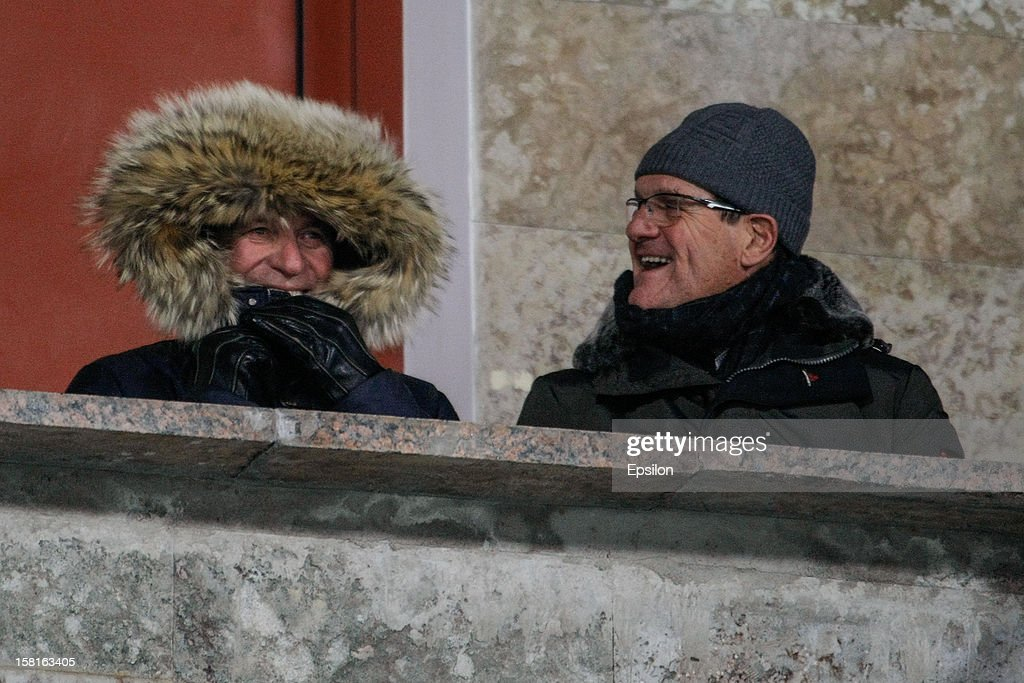 Russia national team head coach Fabio Capello (R) and his assistant Oreste Cinquini attend the Russian Premier League match between FC Zenit St. Petersburg and FC Anzhi Makhachkala at the Petrovsky Stadium on December 10, 2012 in St. Petersburg, Russia.