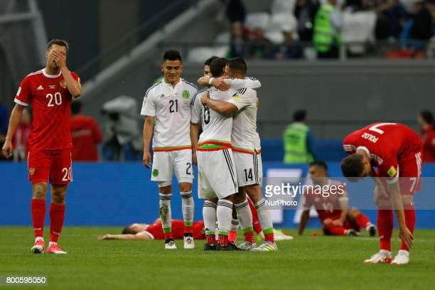 Russia national team players Maksim Kanunnikov Alexander Samedov and Dmitry Poloz react as Mexico national team players Luis Reyes Javier Hernandez...