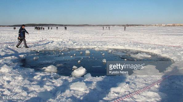 CHELYABINSK Russia Photo taken Feb 16 shows a hole about 8 meters in diameter on the ice of Chebarkul Lake in the Russian region of Chelyabinsk The...
