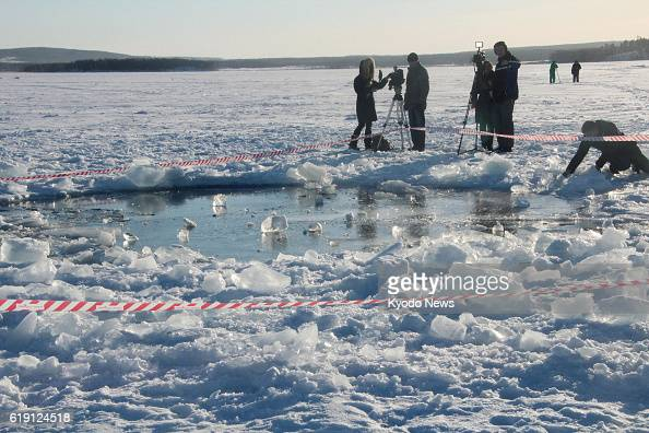 CHELYABINSK Russia Photo taken Feb 16 shows a hole about 8 meters in diameter on the ice of Chebarkul Lake in the Russian region of Chelyabinsk with...