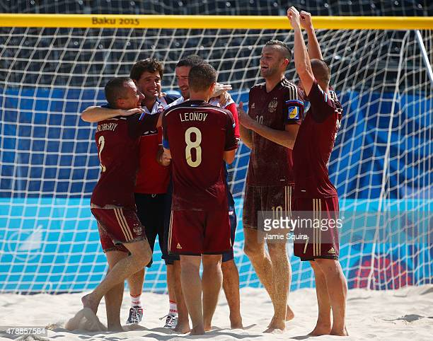 Russia players celebrate winning gold after the Men's Beach Soccer gold medal match between Italy and Russia on day sixteen of the Baku 2015 European...