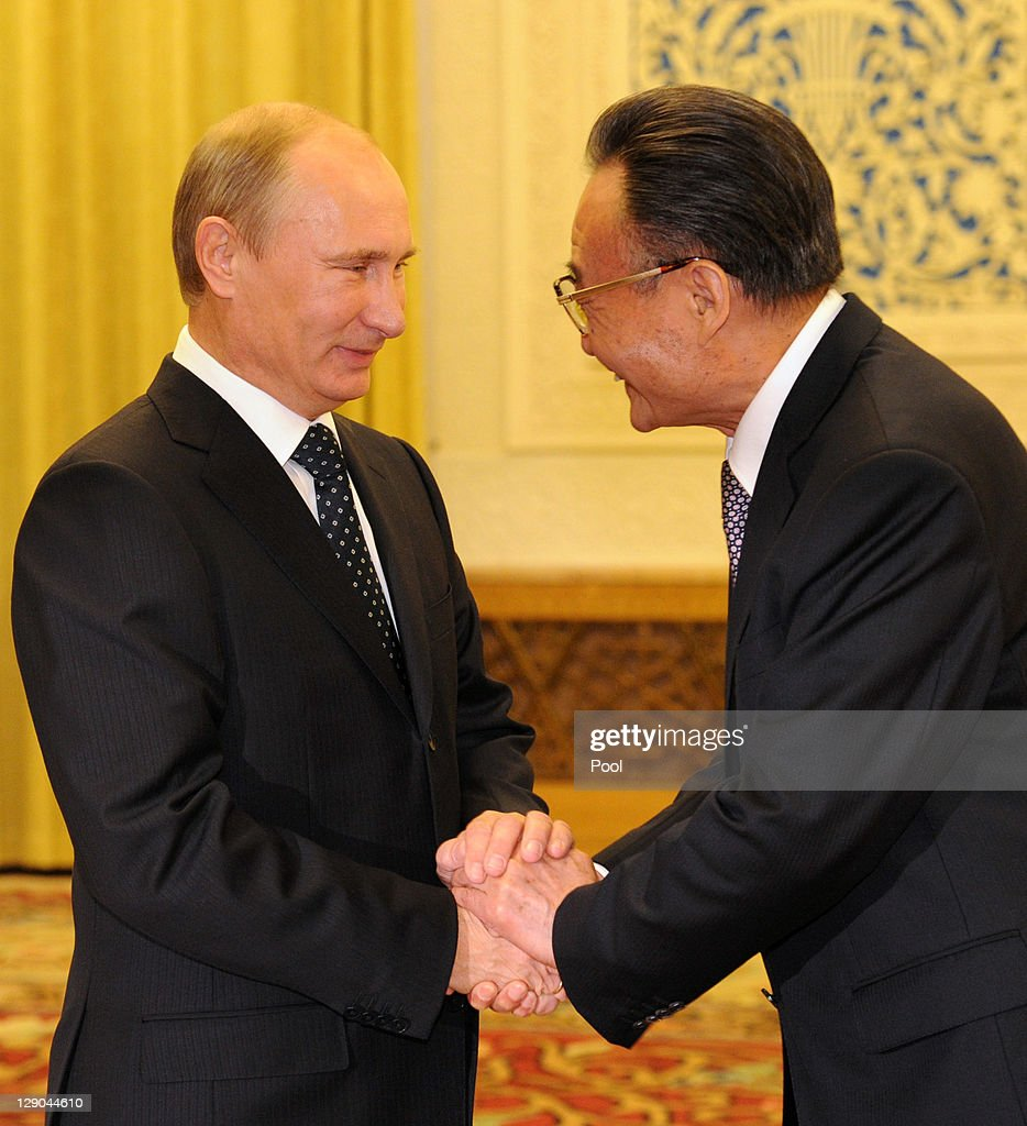 Russia Prime Minister Vladimir Putin and Head of China's legislature Wu Bangguo shake hands at the Great Hall of the People on October 12 2011 in...