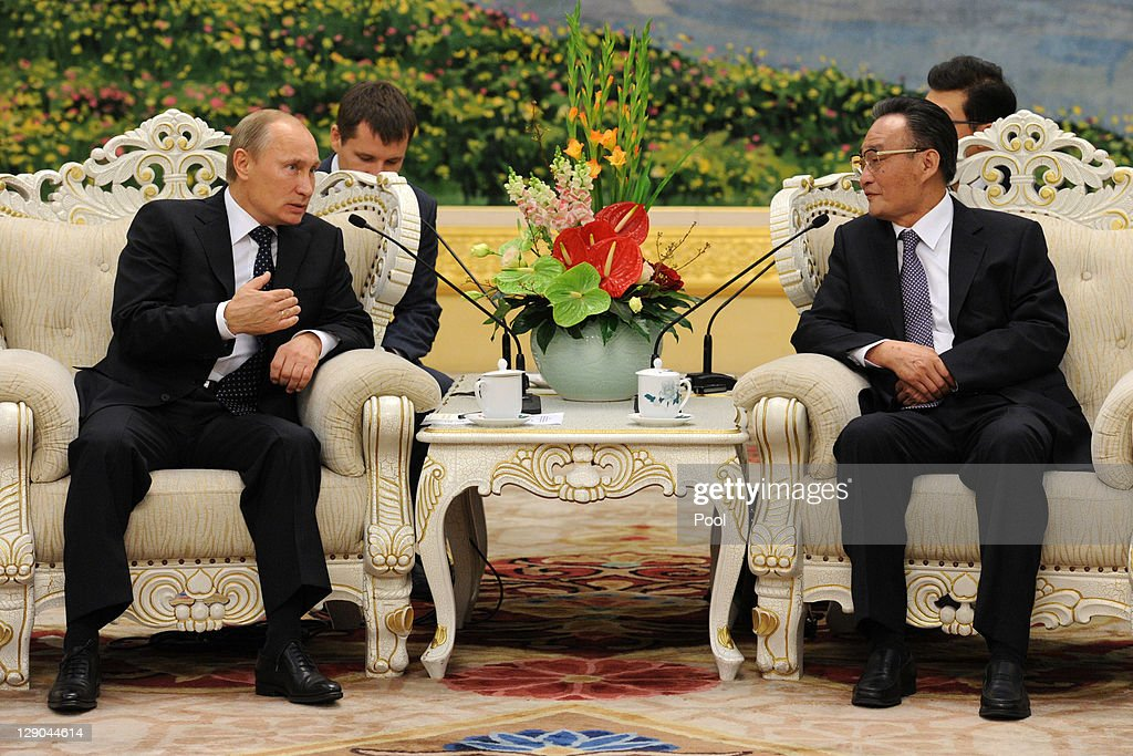 Russia Prime Minister Vladimir Putin and Head of China's legislature Wu Bangguo talk at the Great Hall of the People on October 12 2011 in Beijing...