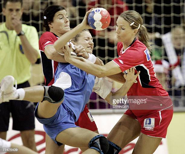Russia' s Irina Bliznova is stopped by Norway's Gro Hammerseng and LinnKristin Rigelhuth during their GF World Cup womens handball semi finals 20...