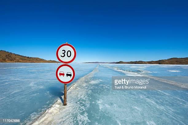 Russia, Siberia, Baikal lake, road on frozen lake