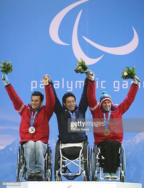 SOCHI Russia Silver medalist Philipp Bonadimann of Austria gold medalist Takeshi Suzuki of Japan and bronze medalist Roman Rabl of Austria celebrate...
