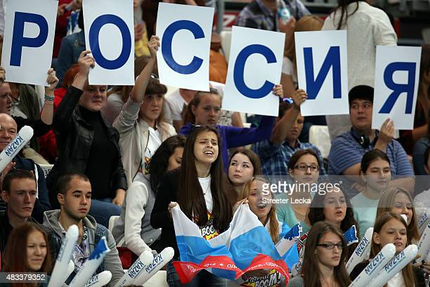 Russia supporters cheer in the Mixed 4x100m Freestyle Relay heats on day fifteen of the 16th FINA World Championships at the Kazan Arena on August 8...