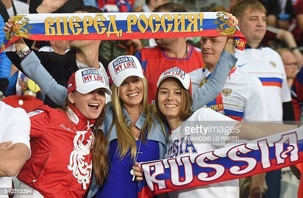 Russia supporters wave scarves ahead of the Euro 2016 group B football match between Russia and Slovakia at the PierreMauroy Stadium in...