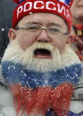 Russia team supporter cheers during the men's 4x75km relay during the IBU Biathlon World Cup in Hochfilzen on December 72013 AFP PHOTO/SAMUEL KUBANI