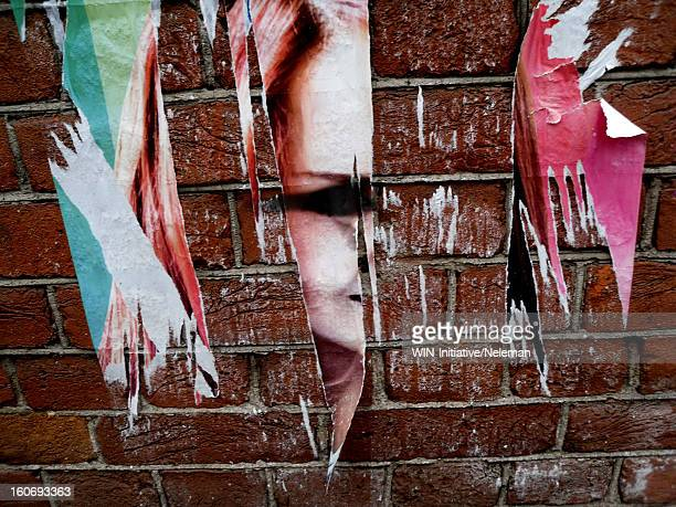 Russia, Torn posters on brick wall