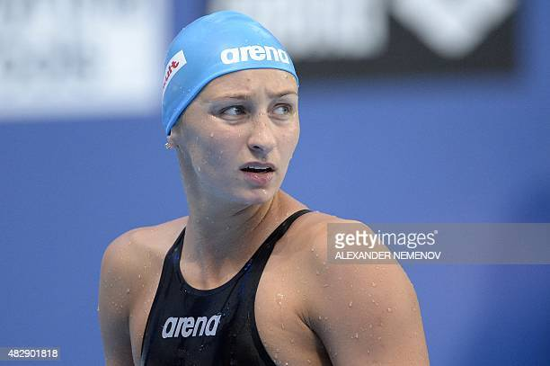 Russia Veronika Popova looks at the time board after a preliminary heat of the women's 200m freestyle swimming event at the 2015 FINA World...