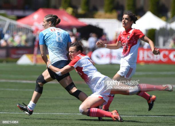 Russia vs France in HSBC Canada Women's Sevens Rugby action at Westhills Stadium in Langford BC May 27 2017 / AFP PHOTO / Don MacKinnon