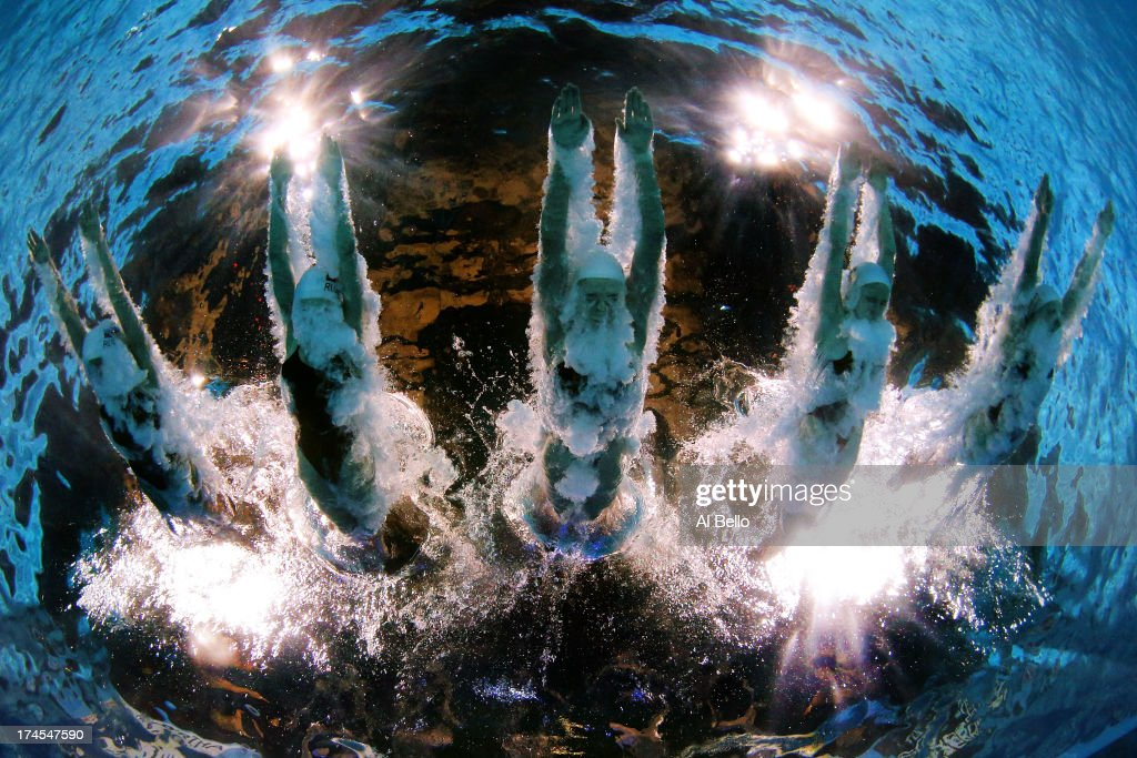 Russia warm up ahead of the Synchronized Swimming Free Combination Final on day eight of the 15th FINA World Championships at Palau Sant Jordi on...