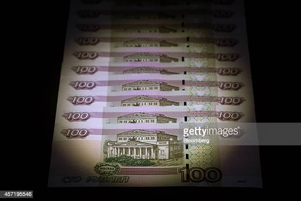 Russian 100 ruble denomination banknotes are seen in this arranged photograph in Moscow Russia on Tuesday Oct 14 2014 Russia shifted the ruble's...
