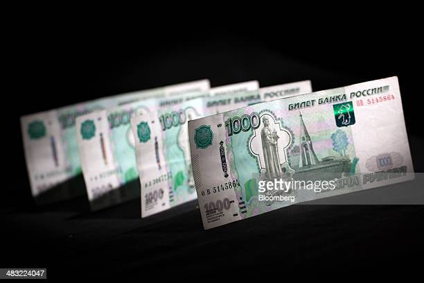 Russian 1000 ruble currency banknotes sit in this arranged photograph at the Thomas Exchange UK Ltd currency exchange in London UK on Monday April 7...