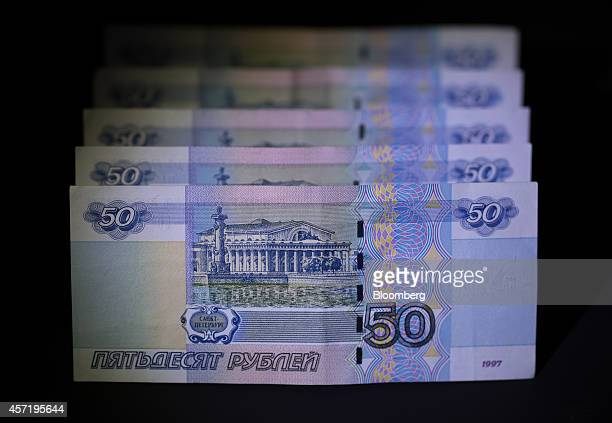 Russian 50 ruble denomination banknotes are seen in this arranged photograph in Moscow Russia on Tuesday Oct 14 2014 Russia shifted the ruble's...