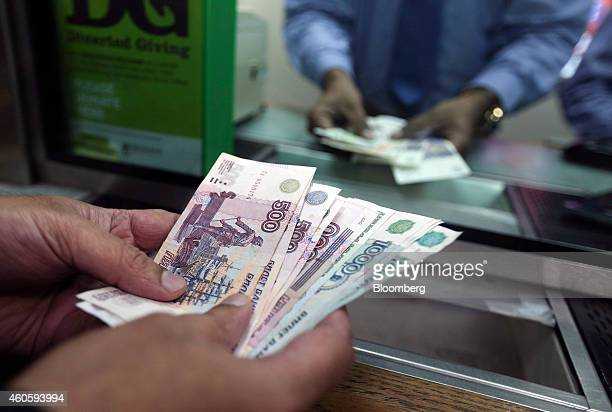 Russian 500 and 1000 denomination ruble banknotes are held by a cashier's tray in this arranged photograph at the Thomas Exchange Global Ltd foreign...