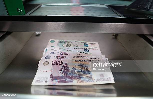 Russian 500 and 1000 denomination ruble banknotes sit in a cashier's tray in this arranged photograph at the Thomas Exchange Global Ltd foreign...