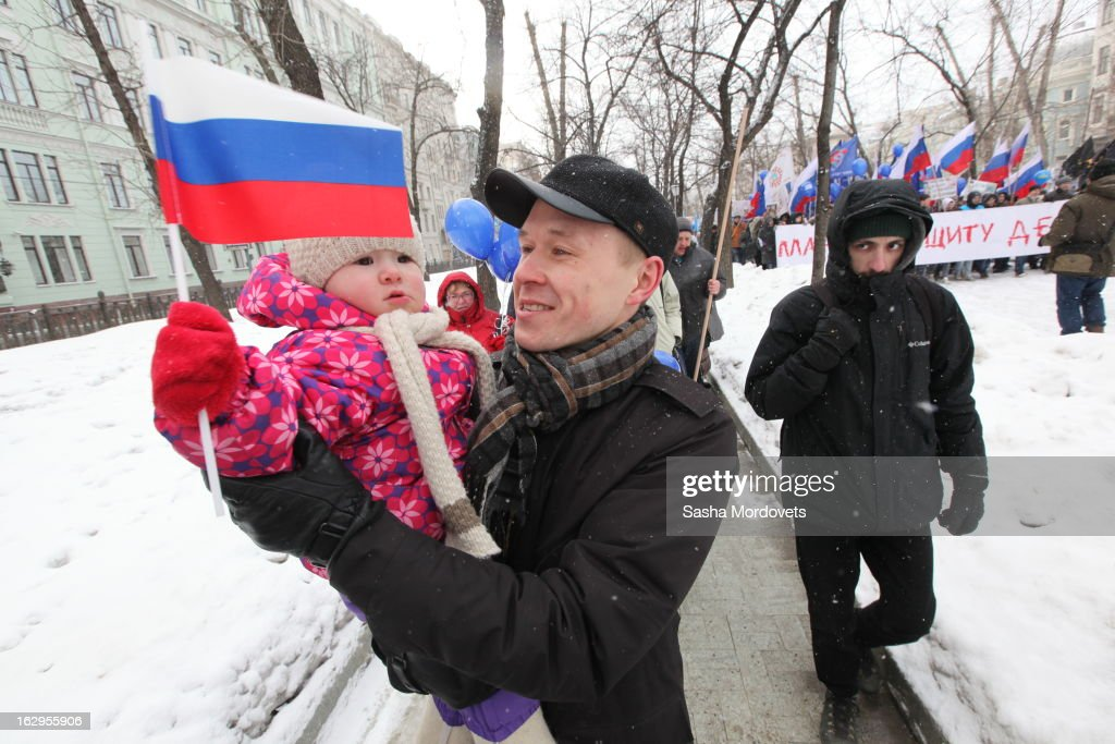 Russian activists and supporters of Pro-Kremlin children advocacy groups participate in the 'Protection the Children' rally on March 2, 2013 in Moscow, Russia. The rally, held in the aftermath of the death of three-year-old Max Shatto (originally named Maxim Kuzmin) adopted by Texan couple Alan and Laura Shatto, called for a ban on all foreign adoptions and the return of the dead boy's brother also adopted by the same couple.