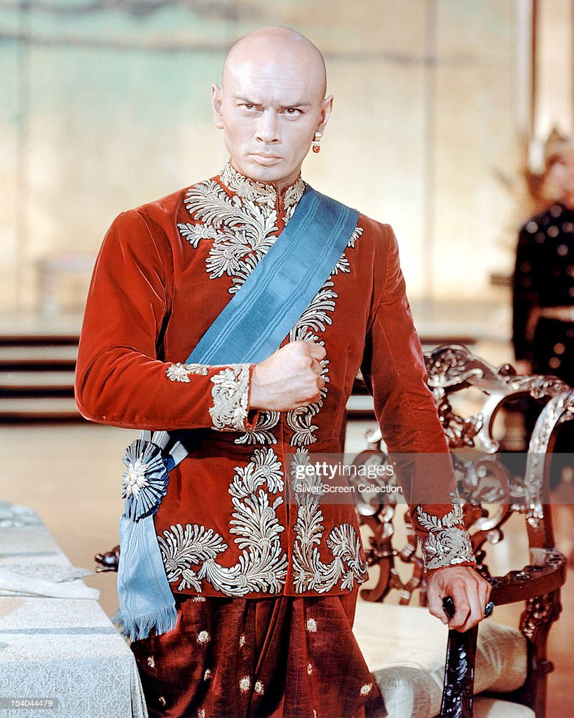 Russian actor <a gi-track='captionPersonalityLinkClicked' href=/galleries/search?phrase=Yul+Brynner&family=editorial&specificpeople=204712 ng-click='$event.stopPropagation()'>Yul Brynner</a> (1920 - 1985) as the King Of Siam in 'The King And I', directed by Walter Lang, 1956.