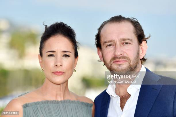 Russian actors Olga Sutulova and Konstantin Khabensky pose during a photocall for the TV drama drama dedicated to Trotsky in the history of Russia...