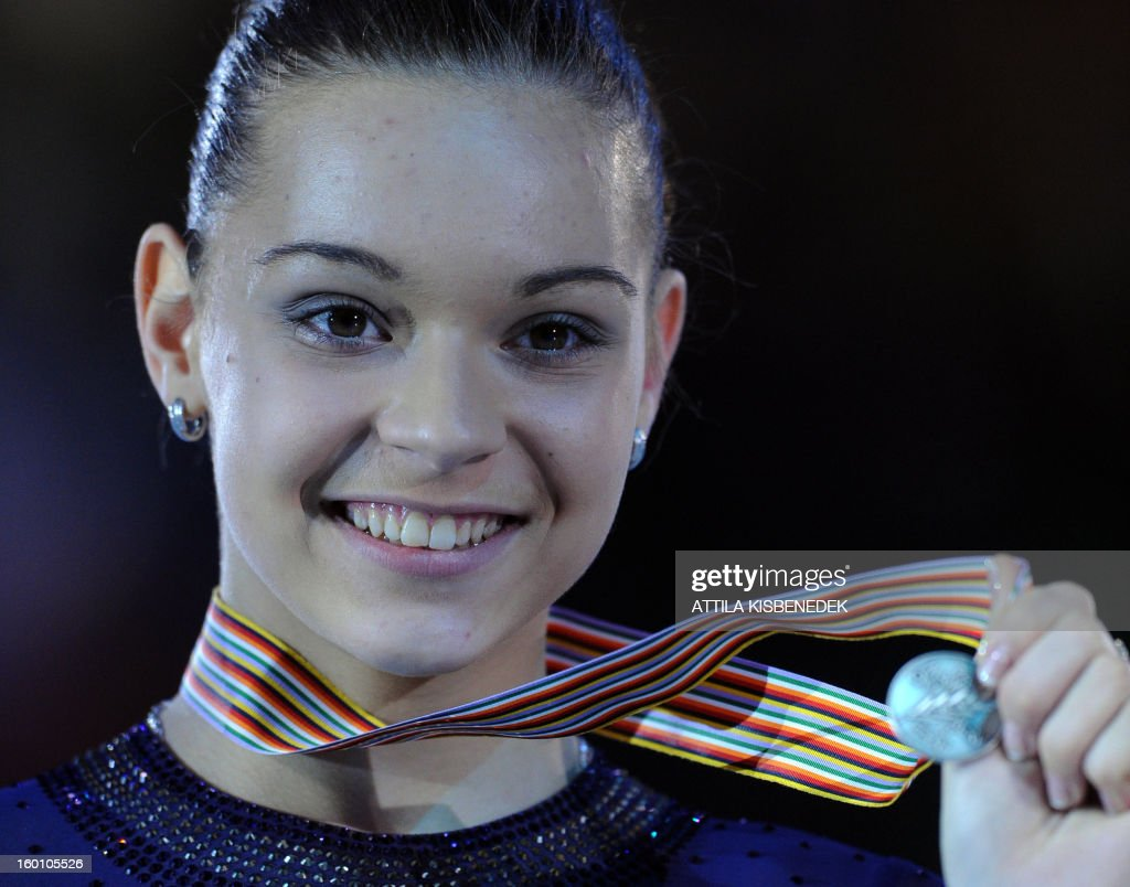 Russian Adelina Sotnikova shows her silver medal on the podium in the Dom Sportova sports hall in Zagreb on January 26, 2013 after the women's free skating event at the ISU European Figure Skating Championships.
