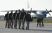 Russian air force pilots walk on the tarmac upon their arrival from Syria at an airbase in the southern Russia's Krasnodar region on March 16 2016...