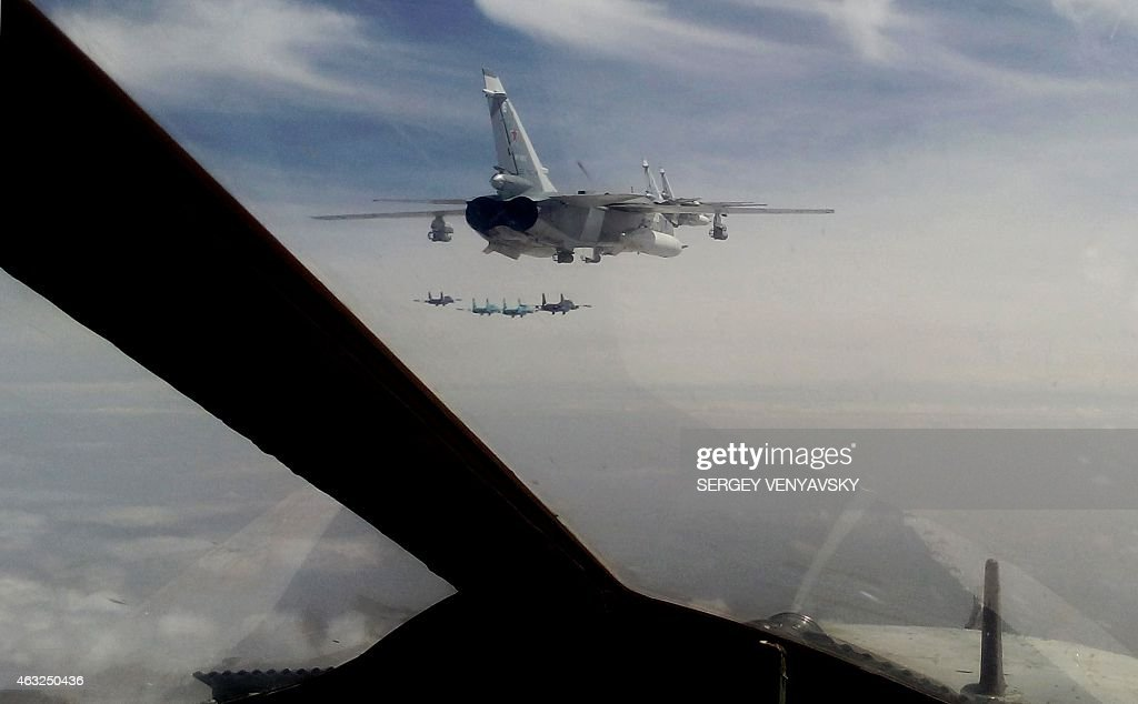 Russian Air Force Su24 bombers fly during a military exercise in southern Russia on February 11 2015 Marathon talks in Belarus ended on February 12...