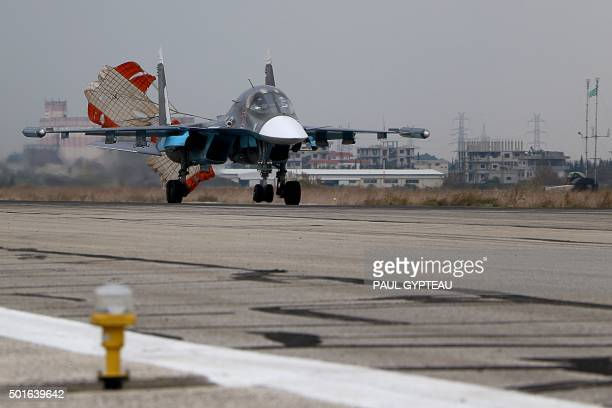 A Russian Sukhoi Su30SM fighter jet lands at the Russian Hmeimim military base in Latakia province in the northwest of Syria on December 16 2015...