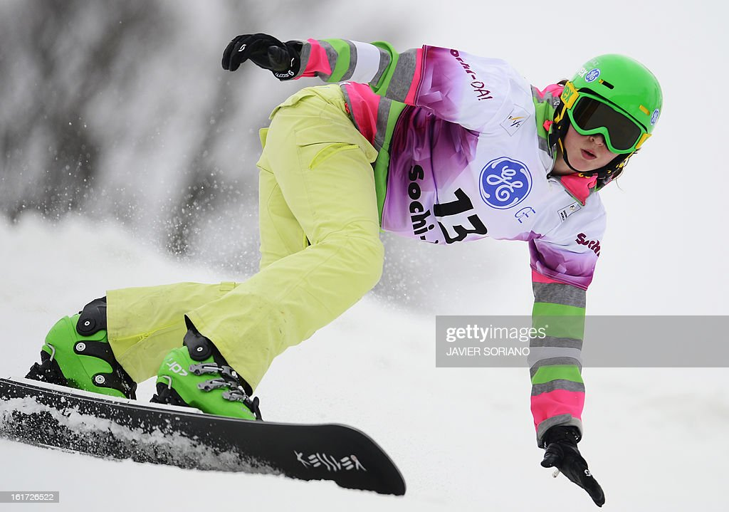 Russian Alena Zavarzina competes in a Snowboard Ladies' Parallel Giant Slalom final race during the Snowboarding and Free Style World Cup Test Event at the Snowboard and Free Style Centre in Rosa Khutor near the Russian Black Sea resort of Sochi on February 14, 2013. Austrian Marion Kreinerwon the race ahead of German Ameli Kober and Canadian Ariane Lavigne.