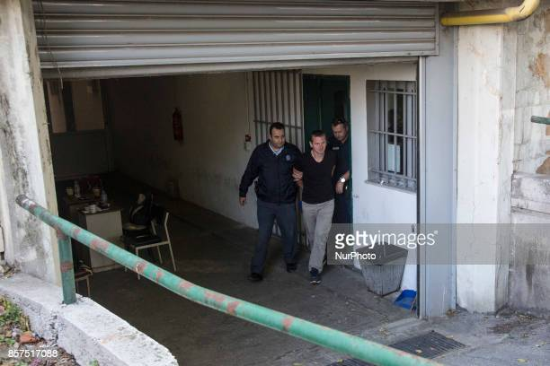 Russian Alexander Vinnik is escorted by police officers as he arrives at a courthouse in Thessaloniki on October 4 2017 Alexander Vinnik who headed...