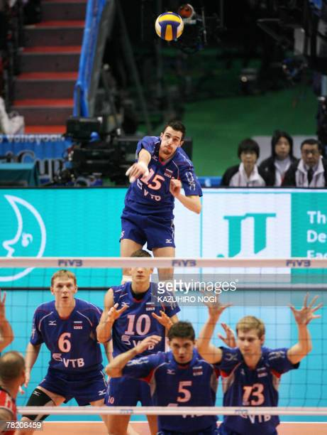 Russian Alexander Volkov serves against the US during their match at the FIVB Men's World Cup volleyball tournament in Tokyo 02 December 2007 Russia...