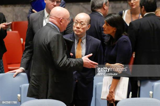 Russian Ambassador to the UN Vasily Nebenzya speaks with US Ambassador Nikki Haley and Chinese Ambassador Liu Jieyi after a UN Security Council...