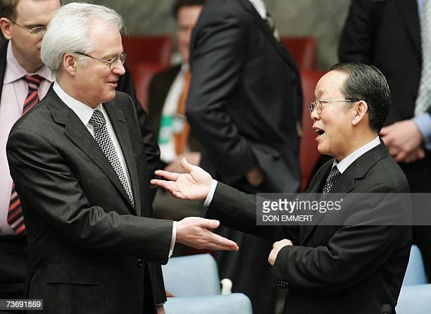 Russian Ambassador to the United Nations Vitaly Cherkin and Chinese counterpart Wang Guangya talk before a United Nations Security Council meeting on...