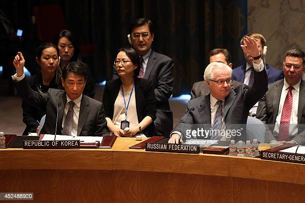 Russian Ambassador to the United Nations Vitaly Churkin votes for a United Nations Security Council draft resolution demanding full access for...
