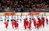Russian and Latvian players wave to the crowd after the men's ice hockey Preliminary Round Group B match between Russia and Latvia during Day 9 of...