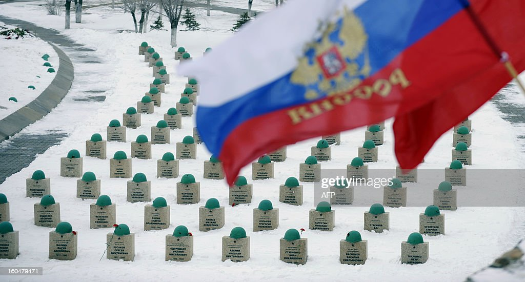 A Russian (L) and Soviet (R) flags fly above gravestones of the Red Army soldiers who died in the Battle of Stalingrad during the World War II, at a military cemetery in the Russian village of Rossoshka, some 40 km outside the city of Volgograd, formerly Stalingrad, on February 1, 2013. In a new display of national pride and reminder of its status as a world power, Russia remembers this weekend the Red Army victory in the battle of Stalingrad over invading Nazi forces, one of the bloodiest battles in human history.