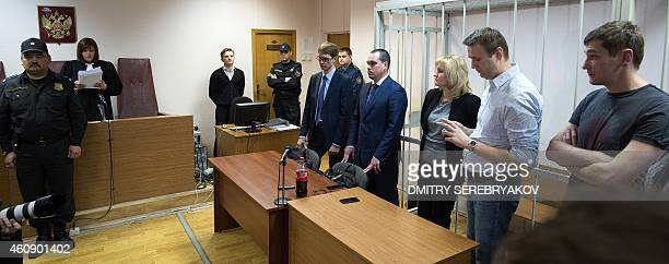 Russian antiKremlin opposition leader Alexei Navalny and his brother and codefendant Oleg listen to the verdict announcement of their fraud trial at...