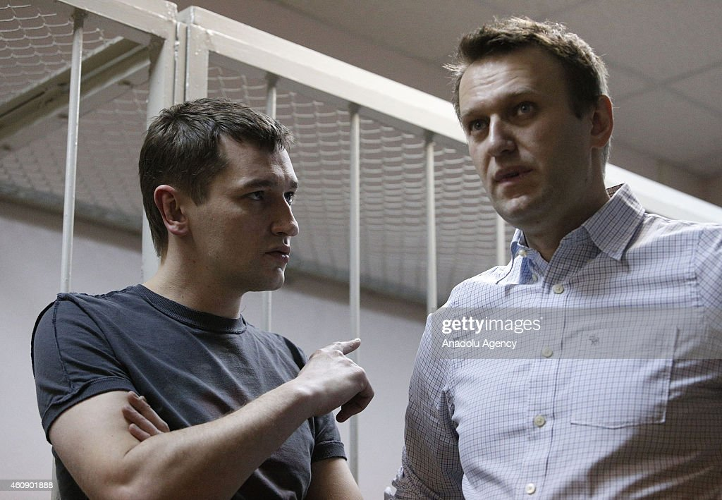 Russian anti-Kremlin opposition leader <a gi-track='captionPersonalityLinkClicked' href=/galleries/search?phrase=Alexei+Navalny&family=editorial&specificpeople=6849046 ng-click='$event.stopPropagation()'>Alexei Navalny</a> (R) and his brother Oleg Navalny (L) attend the verdict announcement of their fraud trial at a court in Moscow on December 30, 2014. <a gi-track='captionPersonalityLinkClicked' href=/galleries/search?phrase=Alexei+Navalny&family=editorial&specificpeople=6849046 ng-click='$event.stopPropagation()'>Alexei Navalny</a>, the anti-corruption campaigner who is a leading foe of Russian President Vladimir Putin, has been found guilty of fraud and given a suspended sentence of three and a half years.