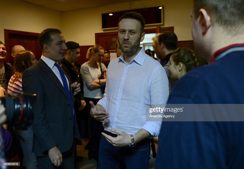 Russian anti-Kremlin opposition leader Alexei Navalny attends the action of objection verdict announcement of their fraud trial at a court in Moscow on February 17, 2015. Alexei Navalny, the anti-corruption campaigner who is a leading foe of Russian President Vladimir Putin, has been found guilty of fraud and given a suspended sentence of three and a half years.