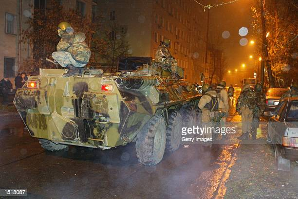 Russian armored personnel carrier guards an avenue near a theater seized by Chechen rebels October 24 2002 in Moscow Russia Three powerful explosions...