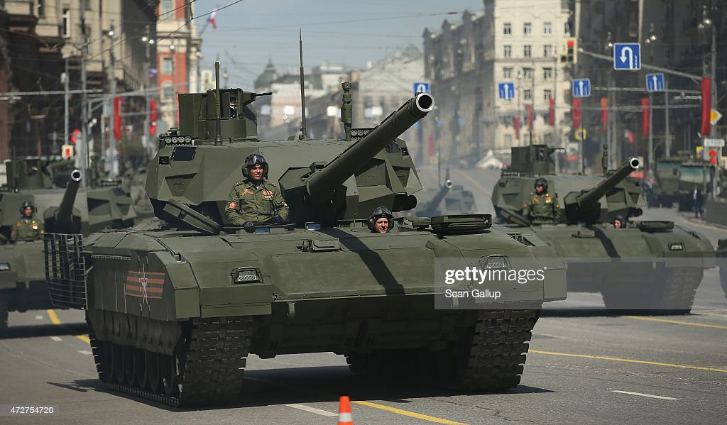 Russian Army T14 Armata tanks drive towards Red Square to participate in the annual Victory Day Parade as part of celebrations marking the 70th...