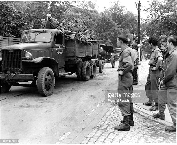 Russian artillery unit rolls past an American convoy of the 3811th Truck Company at Weimer Germany on their way to take over the Leipzig territory...