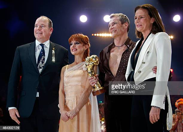 Russian artists of Desire of Flight Valery Sychev and Malfina Abakarova pose with Prince Albert II of Monaco and Princess Stephanie after receiving a...