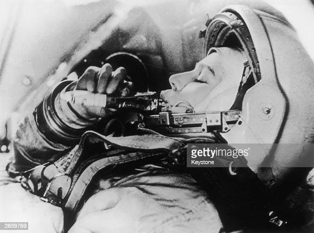 Russian astronaut Valentina Tereshkova practises feeding in simulated flight conditions for her flight as the first woman in space on the Vostok VI...