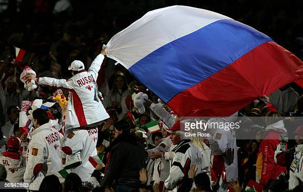 Russian athlete's hold a flag during the Closing Ceremony of the Turin 2006 Winter Olympic Games on February 26 2006 at the Olympic Stadium in Turin...