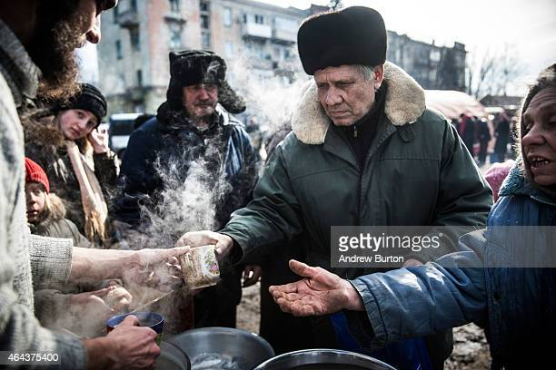 Russian backed rebels serve hot tea to civilians on February 25 2015 in Debaltseve Ukraine After approximately one month of fighting Russian backed...