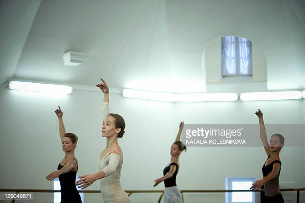 Russian ballerinas rehearse at the Bolshoi Theatre in Moscow on October 12 2011 After years of closure for renovation the main stage of the world...